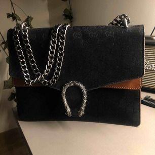Falsk Gucci väska