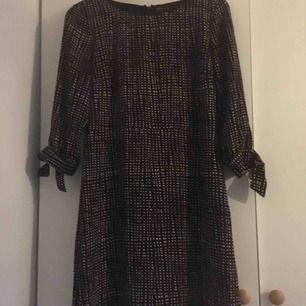 Smårutig klänning från STOCKH LM. Strl 40 Sparsamt använd nyskick Hämtas och betalas i Borlänge