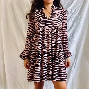 Ganni Lindale minidress. Amazing condition, pink and black tiger print fun, flirty, a little naughty, but like a proper girl.  Size 38 true to size. Free shipping via PostNord with tracking and insurance. Model is 160cm size 38