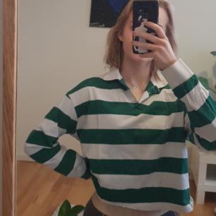Grön och vitrandig