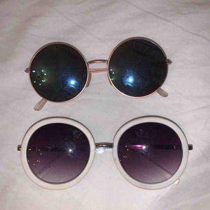 två par runda solglasögon