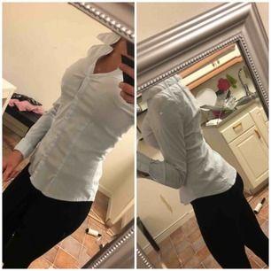 Skjorta i storlek xs.