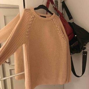Rosa stickad tröja från Atmosphere.