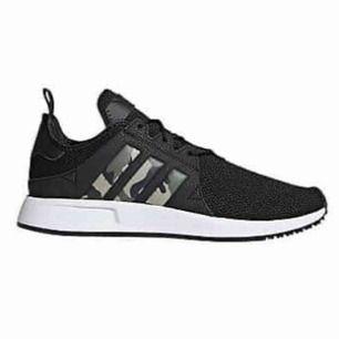 Adidas skor med camo, aldrig använda.