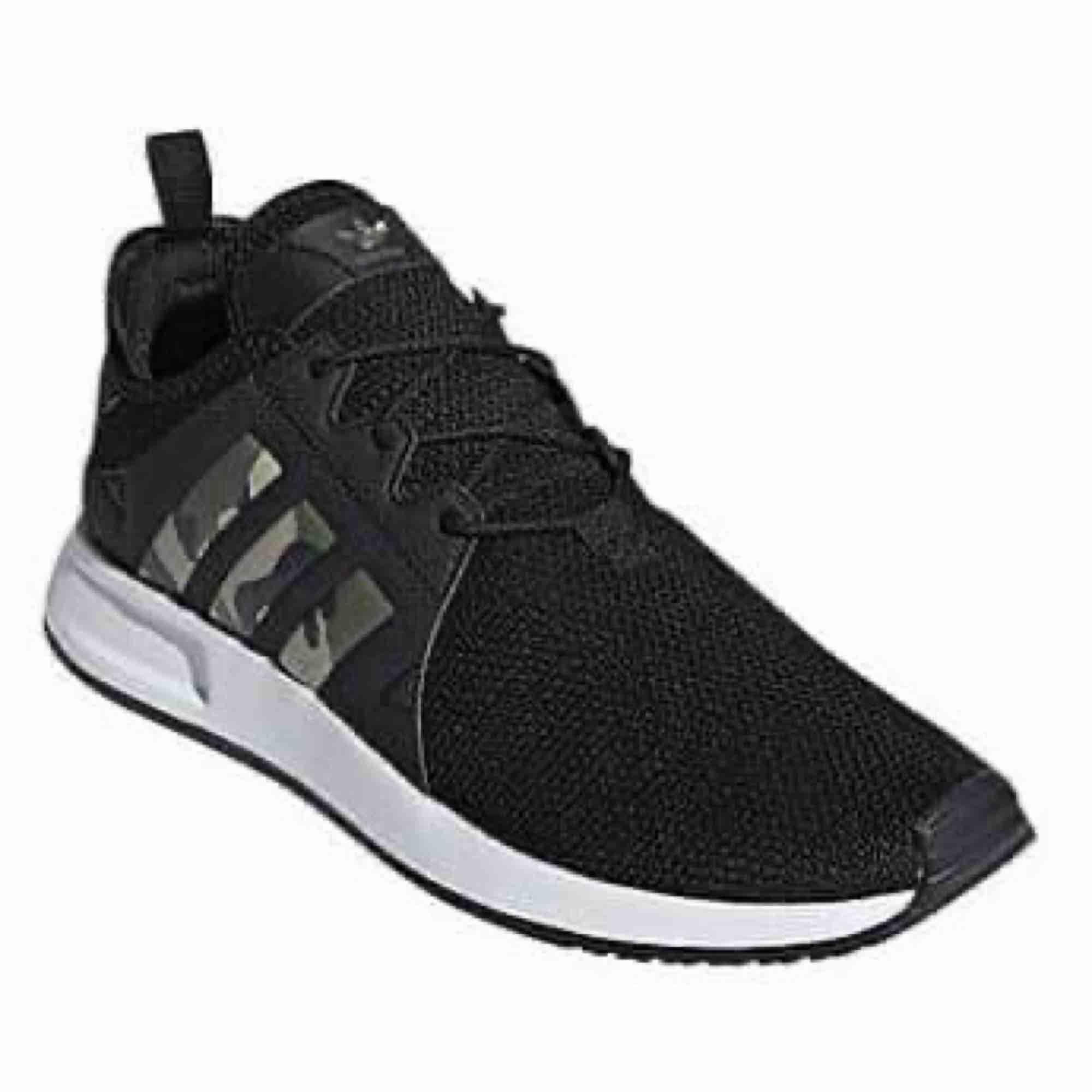 Adidas skor med camo, aldrig använda.. Skor.