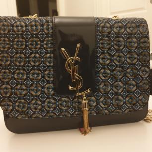 En kopia Yves Saint Laurent väska. Helt ny