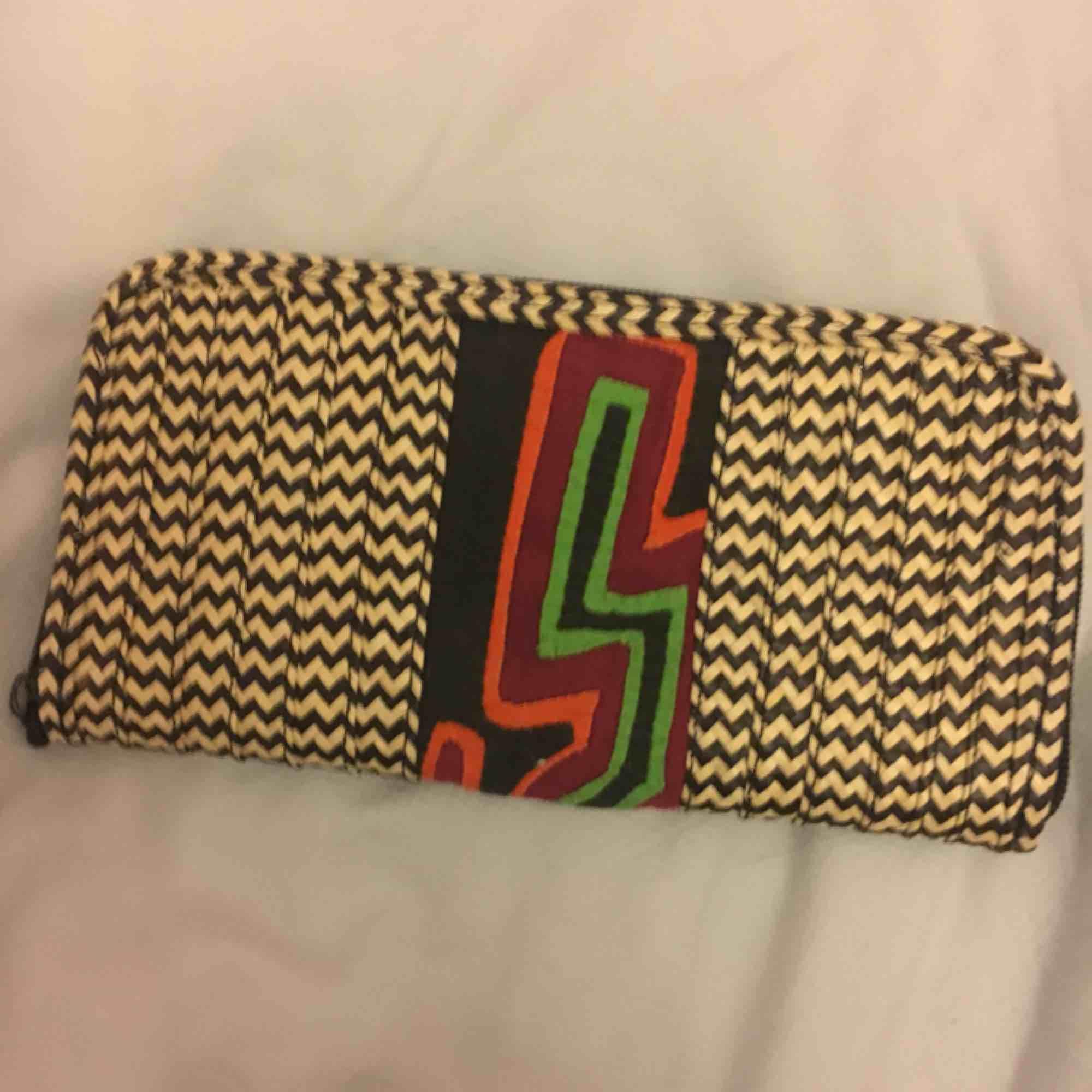 En plånbok från Colombia som är oanvänd . Väskor.