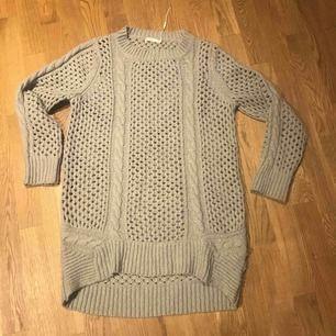 Stickad tröja från Wera. 30% ull Köparen står för frakt