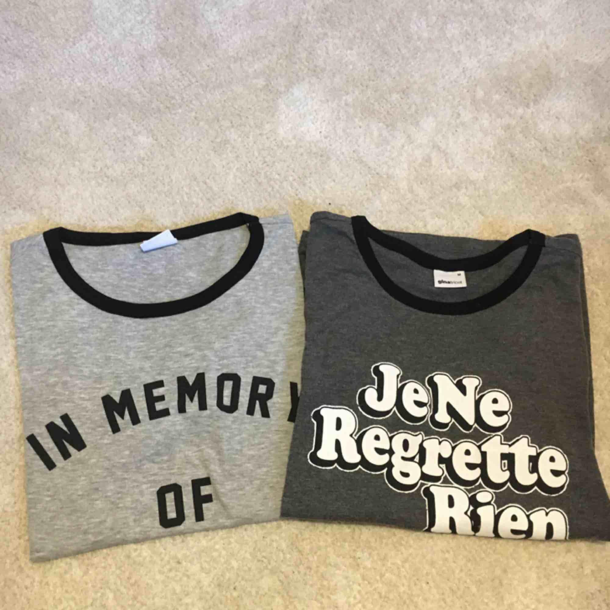 Två Gråa t-shirts från ginatricot med tryck. Säljer en för 60kr och två för 100kr. Små i storleken. köparen står för frakten :). T-shirts.