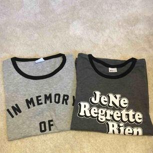 Två Gråa t-shirts från ginatricot med tryck. Säljer en för 60kr och två för 100kr. Små i storleken. köparen står för frakten :)