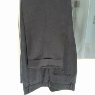 Hugo Boss Pants Gray Dr Hook Wool Pant Slacks Designer: Hugo Boss Model: Dr Hook Made in Turkey. Material: 100% Virgin Wool Color: Gray  Pants: Single pleated front. 2 hip pockets and 2 rear pockets with buttons. Hidden front zipper and button. Gently worn. Excellen Condition.