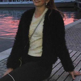 Fluffig jacka från Gina tricot