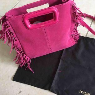 En jättefin rosé maje väska i bra skick!
