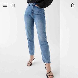 Mom jeans från ginatricot använda sparsamt i storlek 42