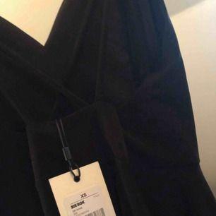 Svart klänning   Ny klänning från bikbok  Storlek XS Pris 90 kr