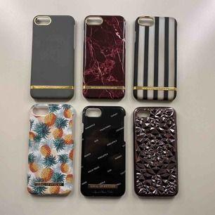 6 stycken iPhone 7 skal. Alla är använda, men är fortfarande i bra skick. Betalning sker via swish. Det svarta skalet med vit text, det gråa och det randiga skalet är sålda