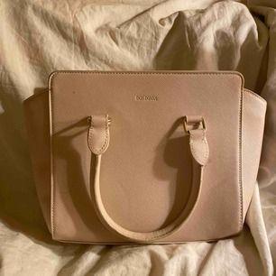 Ljusrosa handväska  Köpt från Don Donna