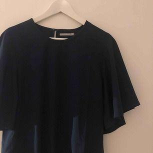 En fin blus som aldrig är använd