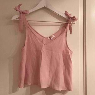 Rosa linne i linnematerial, köpt i Australien. Använt 1-2 gånger.