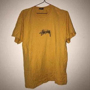 yellow stussy tee size m bra skick