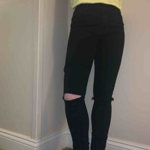 Black ripped knee stretch jeans. Size 26, but fits very small like a 24-25