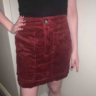 Lovely dark red color, great with tights under or boots