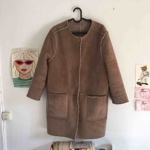 Brown H&M coat/jacket with inside fur. Good condition.