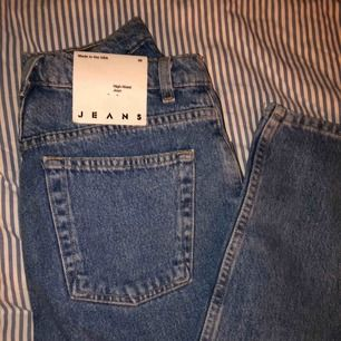 Brand new American Apparel High waist jeans.    Size 28. :))