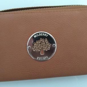 Plånbok av märket Mulberry. Så gott som ny.