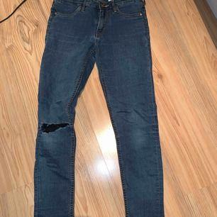 Jeans med hål