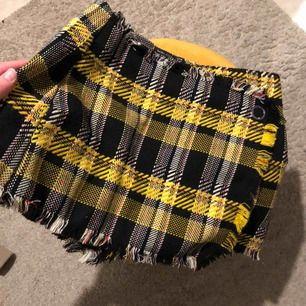 Superfin Clueless inspirerande shorts kjol!  Passar XS och S