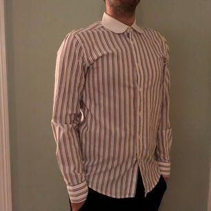 Randig our legacy skjorta säljes pga säljare börjar bli för stor.