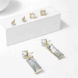 3 silver med guld detalj örhänge