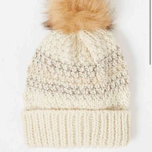 Warm new winter bobble hat. Has some sparkle.
