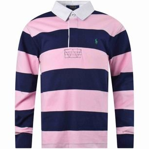 En Ralph Lauren Sport tröja (är lite stor i storleken)