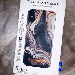 Mobilskal från Ideal of Sweden för iPhone XS, färg Golden Ash Marble, köpt på hemsidan för 328 kr inkl frakt. Använd enstaka gånger.  Bjuder på frakt vid snabb affär.