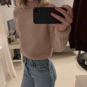 Stickad sweatshirt