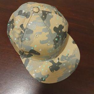 Camouflage cap, size 59. Excellent shape