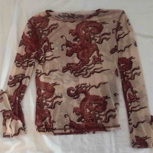 Topp från Urban Outfitters, använd fåtal gånger! Köparen står för frakt :)