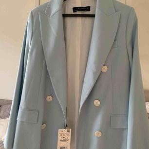 Fin ljusblå kavaj/kostym jacka, aldrig använd (lapp kvar)
