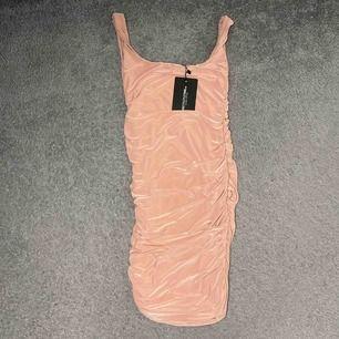 Rushed babypink klänning. Helt oanvänd
