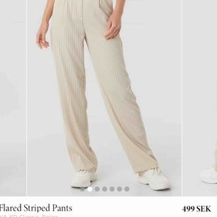 Flared striped pants från NA-KD i storlek 34, knappt använda :) (nypris 499 mitt pris 299)