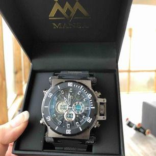 Helt ny och oanvänd Mansa Watch. Klocka med box för 400kr. Skickas med spårbarfrakt för 63kr.