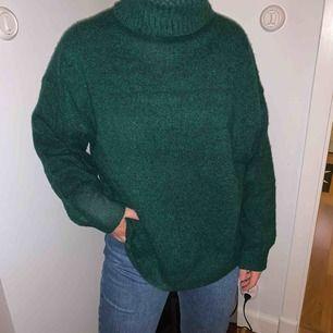 Stickad tröja från H&M i grön färg