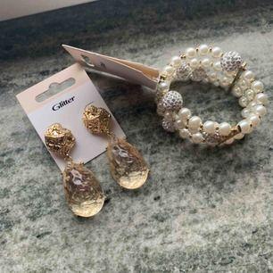 Helt oanvända   Nypris till armband 200kr ,säljar för 80kr Örhängen från Glitter säljar för 70 Örhängen från H&M både för 40kr.