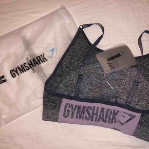 Gymshark Flex Strappy Sports Bra - Grey/Pink storlek M 200 kr + 63 kr porto (skicka lätt)  Helt ny och oanvänd