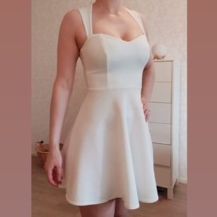 Gorgeous white dress from Nelly in perfect condition. BuyBuyer pays for shipping.