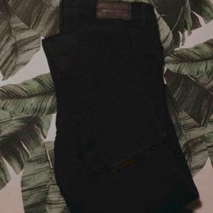 Svarta stretchiga jeans från Molly