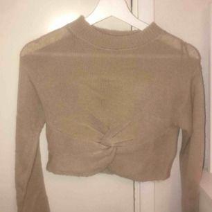 En stickad (sticks inte) tröja från H&M, aldrig använt! bra skick