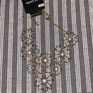 Nypris 149kr prislappen kvar helt nytt säljes för 40kr jätte fint guldigt halsband